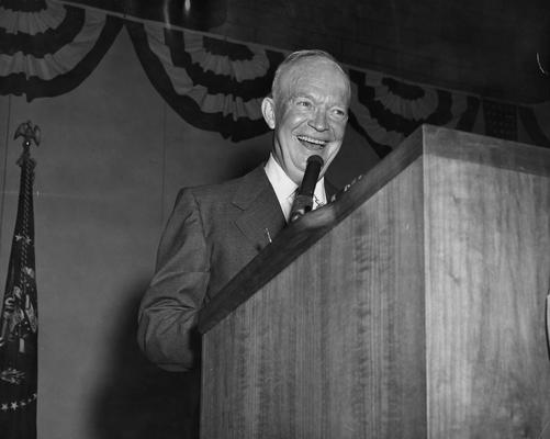 Eisenhower, Dwight D., 34th President of the United States, pictured speaking in Memorial Coliseum, October 3, 1956, at a stop during his campaign for a second term as President, Public Relations Department photograph, Photographer: Simmons Studio, featured in 1957