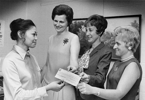 Fendley, Estella, Assistant Advisor for International Students, pictured (left) accepting a donation to the Nell Donovan International Student Loan Fund from Mrs. Robert Kiser, Mrs. Daniel Arnold and Mrs. William Peters, May 25, 1971, Public Relations Department