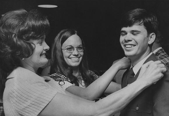 Fletcher, Ernie, Alumnus, United States Representative from Kentucky and Governor of Kentucky, pictured receiving Air Force Lieutenant bars at the ROTC commissioning ceremony, bars are pinned on by Fletcher's mother and his spouse, Glenna Foster Fletcher, May 16, 1974, Photographer: Public Relations Department