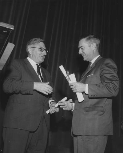 Francis, Sir Frank, pictured receiving the Kentucky's Colonel Commission from President Frank G. Dickey in the Guignol Theater, April 30, 1963
