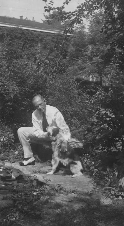 Funkhouser, William D., Professor of Zoology and Anthropology, Anthropology Department, Dean of Graduate School, pictured with pet dog