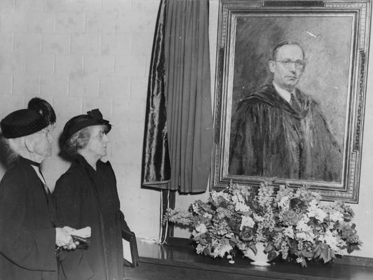 Funkhouser, William D., Professor of Zoology and Anthropology, Anthropology Department, Dean of Graduate School, Photo of portrait of Funkhouser unveiled by Mrs. Hugh Clark Funkhouser (left), mother of W. D. Funkhouser and Josephine Funkhouser, wife of W. D. Funkhouser