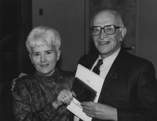 Gaines, John R., Member of Board of Trustees, 1975 - 1978 Photographer: Public Relations, pictured receiving Public Service Award from Bess Wilson, President of Friends of Kentucky Libraries, featured in March 26, 1992