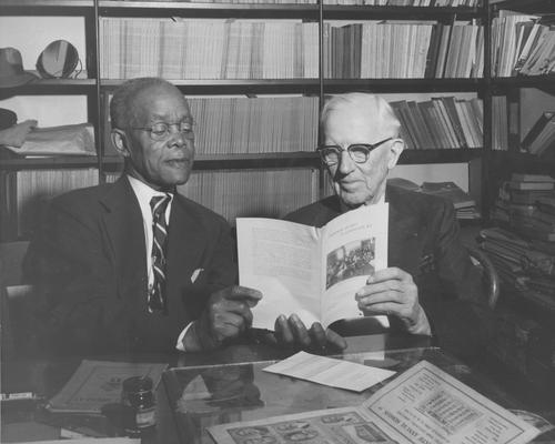 Gillis, Ezra L, death 1958, Registrar of University 1913-1937, Special Work 1937-1954, Instructor Normal Department 1907-1910, Began Bureau of Source Materials in Higher Education 1937-1958, pictured (right) with Allie Washington, African-American janitor of Lexington City Hall, discussing Lexington schools and education, featured in Lexington Herald or Leader, October 25, 1954