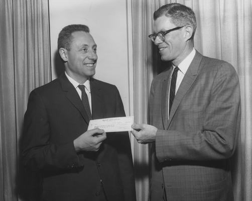 Githens, John H., Chair, Department of Pediatrics, pictured receiving a research donation from W. H. Rennie of Wyeth Laboratories, April 18, 1962, Photographer: Mack Hughes