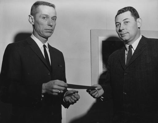 Graves, Charles P., Professor and Chair, Department of Architecture, pictured (right) receiving scholarship grant, to aid graduate students, from Lee Potter Smith, a Paducah architect, February 1961