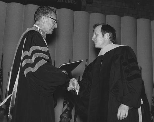 Greene, John Clifford, pictured (right) receiving honorary degree, 1972, former president Otis Singletary is on the left, University Information Services