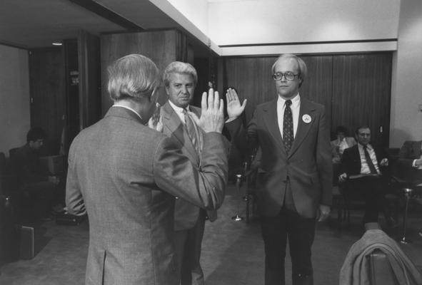 Griffin, George W., Member of Board of Trustees, 1968 - 1981; 1983 - 1989 pictured  (center) taking oath of office with unknown individual