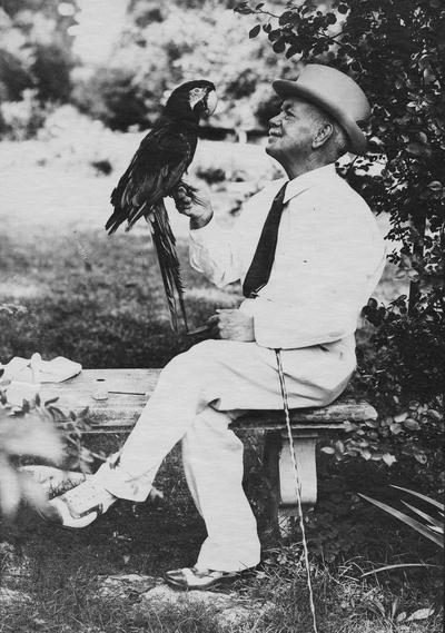 Anderson, F. Paul, Dean of Mechanical Engineering, 1892 - 1918, Dean of Engineering, 1918 - 1934, birth 1867, death April 8, 1934, Anderson with large parrot on his finger