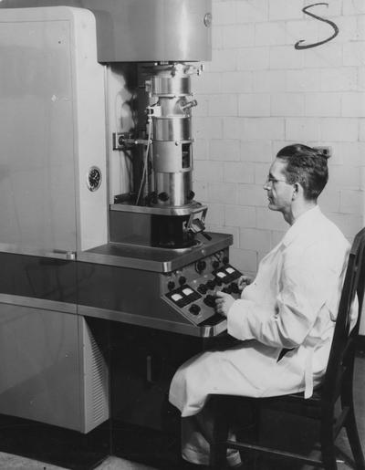 Hamilton, Dr. Brooks, Using an Electron Microscope, Photographer: W.E. Sutherland, Public Relations Department