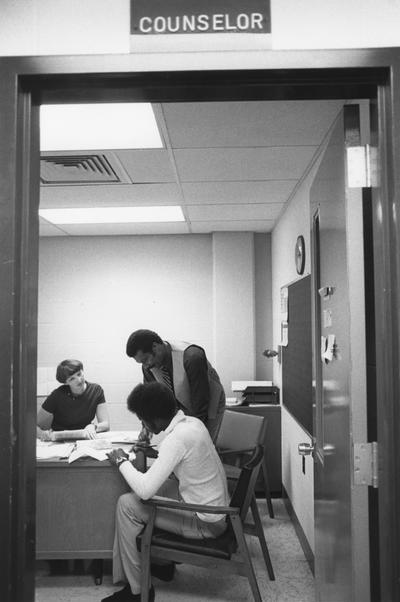 Hanley, Alvin C., Director of Minority and Disadvantaged Recruitment, in the counselor's office at Valley High School, with a student and a counselor, Louisville 1978