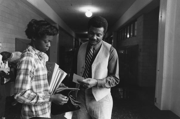 Hanley, Alvin C., Director of Minority and Disadvantaged Recruitment speaks with a student in the halls of Valley High School, Louisville