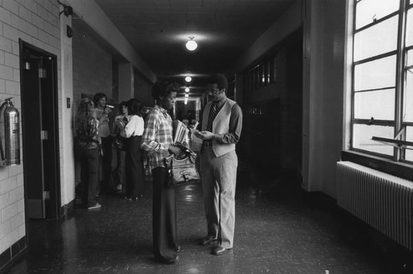 Hanley, Alvin, C., Director of Minority and Disadvantaged Recruitment talks to a Valley High School studetn in the halls of her school, Louisville