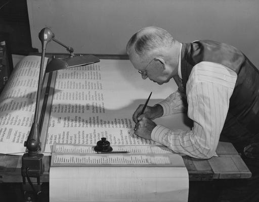 Horine, John Sherman, Professor of Mechanical Engineering, inscribing the names of Kentucky's 9,945 World War II dead on a roll of honor to be placed in the University of Kentucky's Memorial Coliseum, 24 sheets will be needed for the inscription of the names, sheets will be placed in wall panels, photograph by John B. Kuiper, Public Relations Department