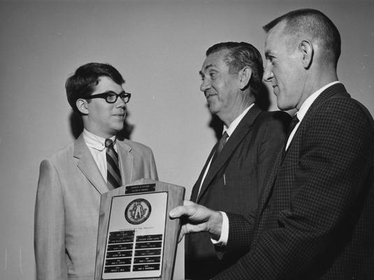 Barrickman, John R., receives the Annual Wall Street Journal Student Achievement Award, pictured with Professor Herman A. Ellis and Clyde L. Irwin, Associate Dean of College of Business and Economics