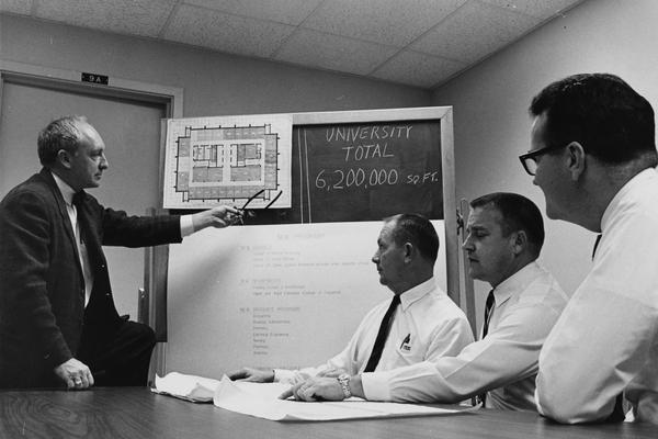 Barrows, John E., Director of Institutional Studies (Office of Executive Vice President), pictured with Charles King, Jr. and Donald Clapp, viewing plans for Patterson Office Tower, Public Relations Department