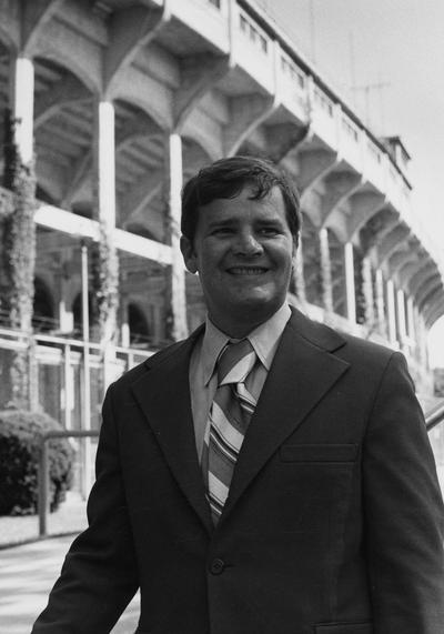 Bell, Thomas, Member of Board of Trustees, 1970 - 1973 ; 1983 - 1986, University of Kentucky Alumnus, pictured in front of Stoll Field