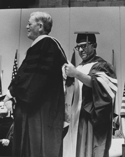 Massie, Dr. Francis, pictured receiving Honorary Degree from Dr. Ralph Angelucci / Trustee