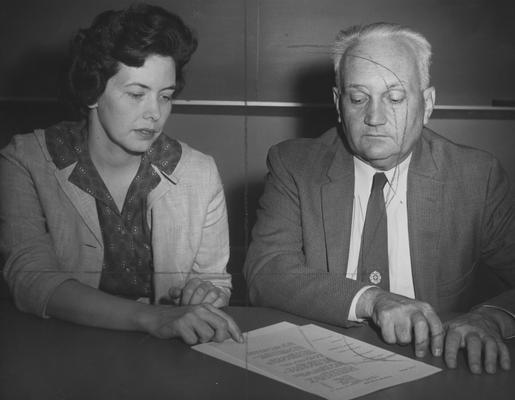Ressor, Margaret Elaine, Assistant Professor of Ancient Languages and Literatures, pictured talking over plan for the academic year with Dr. Jonah W.D.Skiles, head of the University of Kentucky Department of Ancient Languages and Literatures, Reesor is the first woman to teach in the department, from Public Relations Department