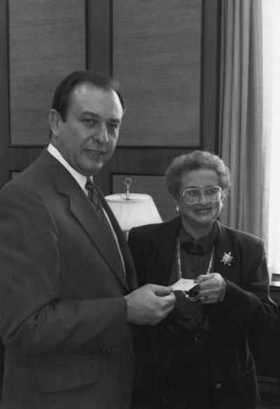 Rose, Harriet, Associate Professor of Department of Psychology, pictured presenting $1000 check to President Wethington for Commonwealth Library, from Public Relations Department, Publications Bureau