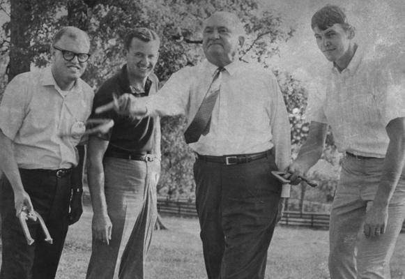 Rupp, Adolph, University of Kentucky Basketball Coach 1930-1971, committe of 101, pictured playing horseshoes, Dan Issel is pictured far right, photograph by Lexington Herald Leader Staff Photo