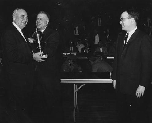 Rupp, Adolph, University of Kentucky Basketball Coach 1930-1971, recieving award, from Public Relations Department