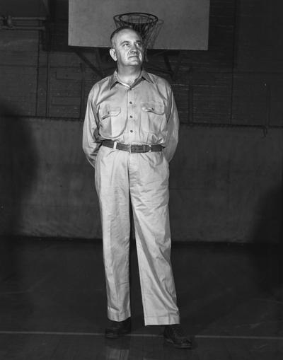 Rupp, Adolph, University of Kentucky Basketball Coach 1930-1971, pictured in practice clothes in Alumni Gym