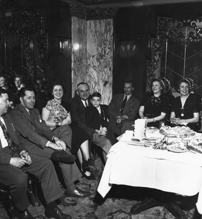 Rupp, Adolph, University of Kentucky Basketball Coach 1930-1971, pictured fourth from left with son Herky at party honoring Rupp