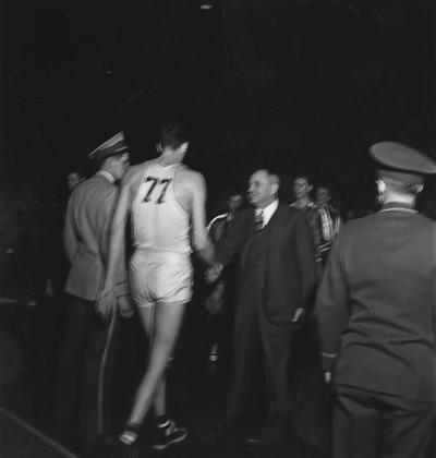 Rupp, Adolph, University of Kentucky Basketball Coach 1930-1971, pictured shaking hands with Bill Spivey