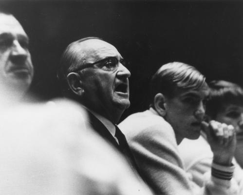 Rupp, Adolph, University of Kentucky Basketball Coach 1930-1971, pictured on bench during basketball game