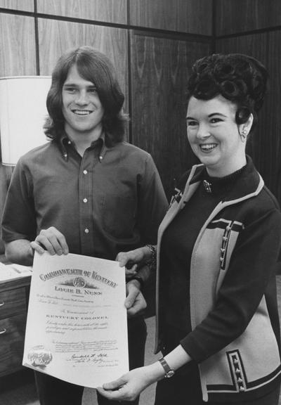 Schiefferle, Ralph, pictured receiving a Kentucky Colonel certificate during the Governor Louie B. Nunn administration, from Public Relations Department