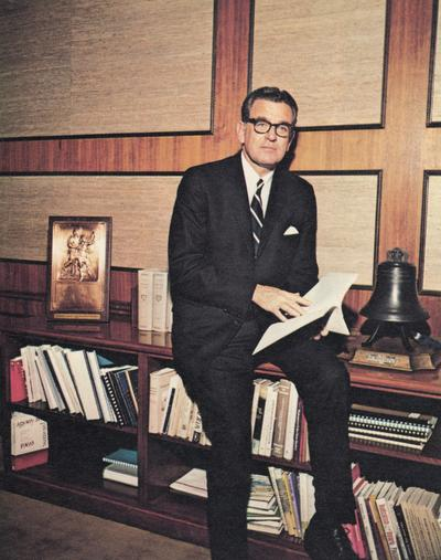 Singletary, Otis A., University of Kentucky President 1969-1987, pictured seated at credenza in his office, from Singletary papers