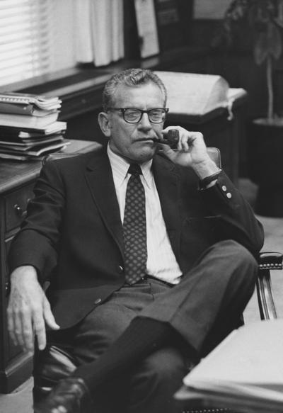 Singletary, Otis A., University of Kentucky President 1969-1987, pictured smoking a pipe