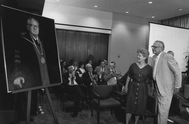 Singletary, Otis A., University of Kentucky President 1969-1987, pictured observing the official Singletary Portrait, Photographer: Public Relations Department