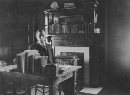 Smith, Guy, Instructor of Mathematics 1918-1920, pictured in his room during Christmas time