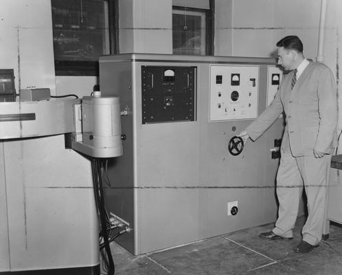 Boyer, Robert, Professor, Chemistry Department, observing new equipment, Department of Public Relations photograph, Photographer, Hack Hughes Studio