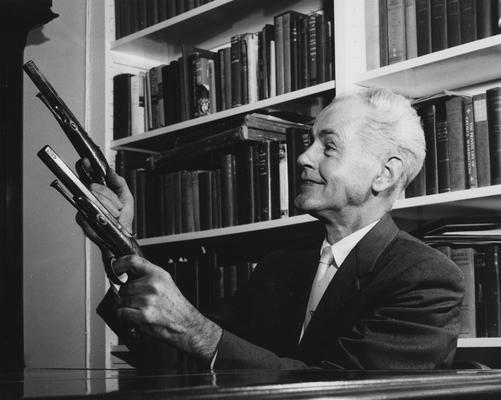 Tapp, Hambleton, pictured at Waveland Kentucky Life Museum holding two guns