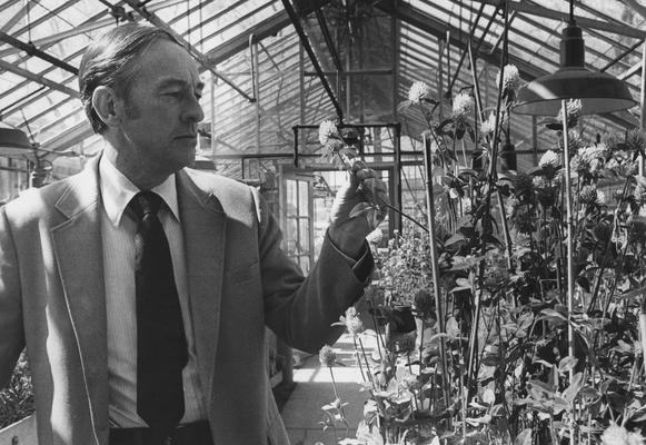 Taylor, Norman L., 1949 alumnus pictured in Greenhouse, from University Information Services