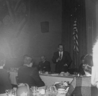 Thompson, Lawrence S., Director of Libraries 1948-1965, Professor in Classics 1965-1979, pictured speaking at a book fair dinner in Bluefield WA
