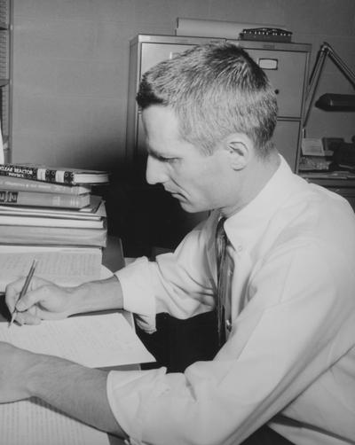 Thorpe, James, Nuclear Engineering Department, pictured at desk, from Public Relations Department