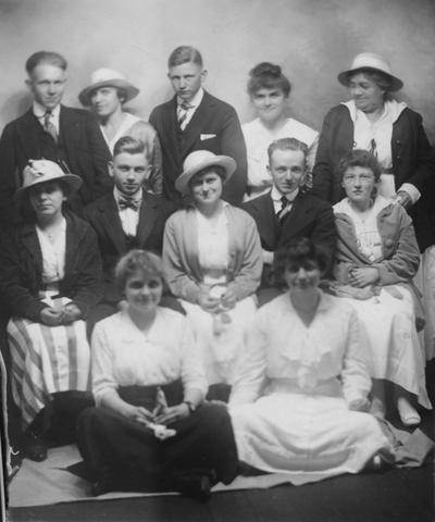 Tuttle, Margaret, Class of Morton High School in Lexington, KY, Now in 2005, it is a Junior High or sometimes referred to as a Middle School, these are the graduating seniors at a picnic at Bluegrass Park in 1891, Margaret Tuttle is on the second row, the first woman on the left and wearing a hat, her face is shaded by the hat, Margaret was a librarian 1926-1964 at the University of Kentucky Library, she graduated from the University of Kentucky in 1915 with a A.B., B.S., and L.S. Degrees, she was a student assistant 1926-27