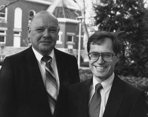Voss, Harwin L., Professor of Sociology, pictured right standing with R. R. Clayton, photograph by Ken Goad, from University Information Services