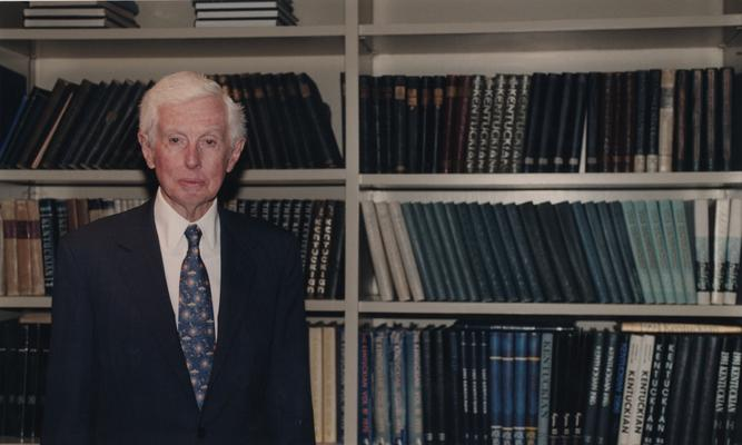Young, William T. Sr., he was a member of the Board of Trustees, Pictured at the dedication of the William T. Young Library, Young is a philanthropist, businessman, and owner of Overbrook Horse Farm, Instrumental in book endowment and building of William T. Young Library, pictured standing in front of bookcase