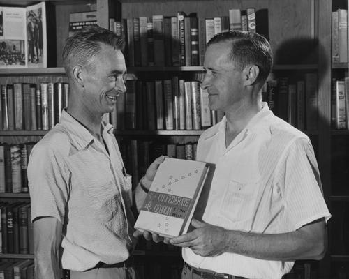 Bryan, Thomas Conn, Instructor, Department of History, 1945 - 1946, pictured (after moving to the Department of History at North Georgia College, Dahlonega) presenting a copy of his book to John H. Brendle of the Library at Fontana Village