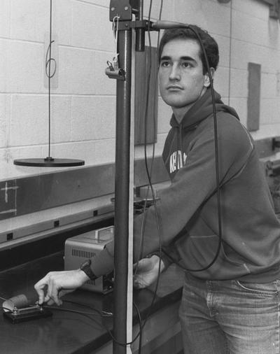 Wade, Tommy, Student of Chemistry and Physics, pictured in laboratory, photographer: Bill Wells, Photographic Services Image # 26576