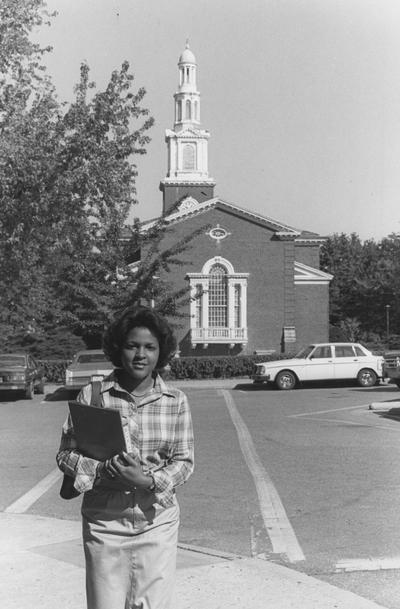 Unidentified, African American woman standing behind Memorial Hall, photographer: Student Affairs / Dean of Students