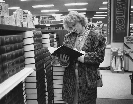 Unidentified, student in the University of Kentucky Bookstore, Photographer: Clay Owen,  Photographic Services Negative File-Regular Series 27583