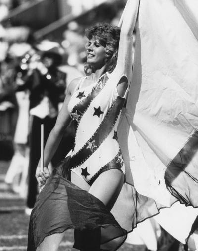 Unidentified, University of Kentucky Football Flag Corp woman (Marching Band), photographer: John Mitchell