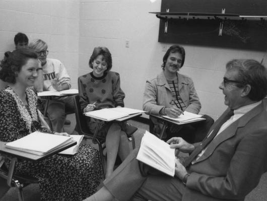Davenport, Guy M., Professor of English, shown in classroom with students