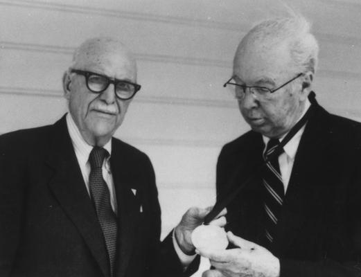 Cogar, James L., Alumnus, A. B. 1927, shown here receiving the Shakertown Medal from Earl D. Wallace, Alumnus, B. S. 1921